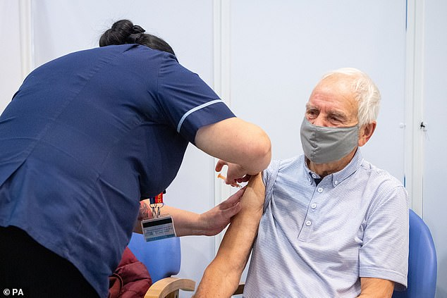 Covid vaccines are being offered to all elderly people in Britain in the next five weeks as the Government aims to get jabs to all those most at risk of dying from coronavirus by mid-February (Pictured: A man receives his jab at Epsom Racecourse in Surrey)