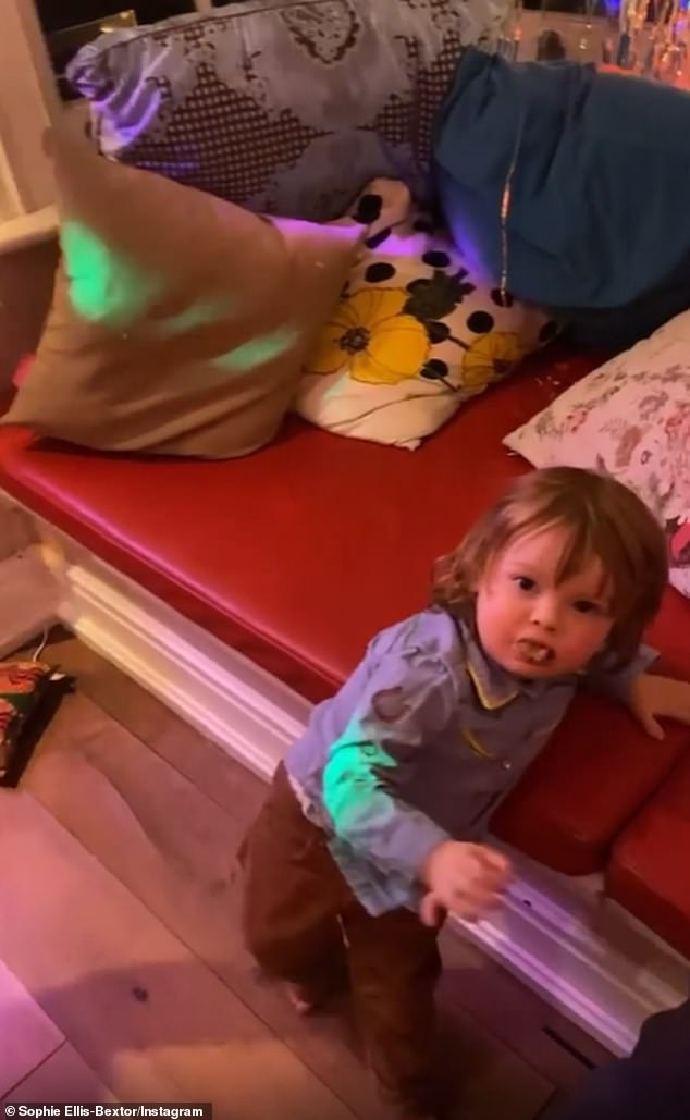He's fine:The cute tot - who is the youngest of the five sons Sophie shares with husband Richard Jones - was seen trotting across the kitchen in front of his mother when he fell flat on his face
