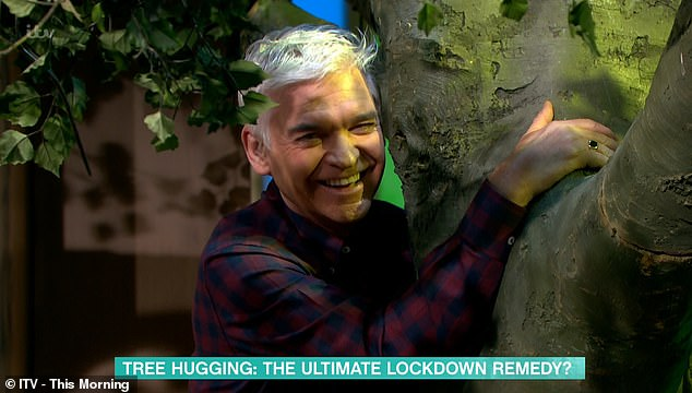 Presenters Holly and Phil then decided to give the method a go, being guided through meditation while hugging some fake trees in the studio