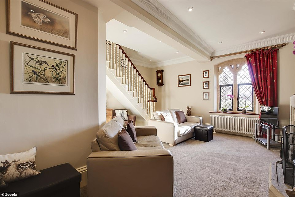 Features include decorative large windows that overlook the extensive grounds and provide plenty of light inside