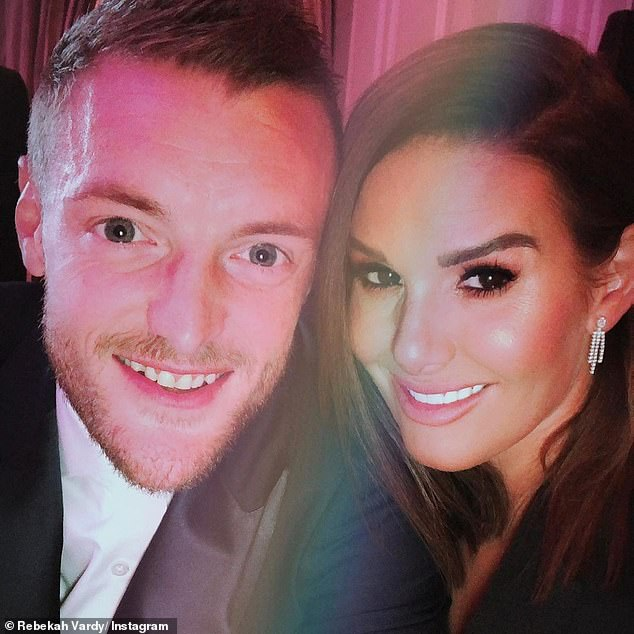 Blissfully married: The WAG, 38, shared a glamorous photo alongside her husband on the celebratory post, in addition to photos of Jamie bonding with their babies
