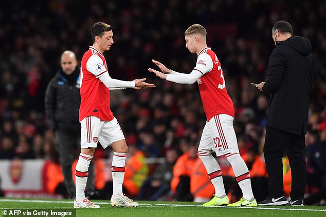 Smith Rowe has eased the pressure on the Gunners after they omitted Mesut Ozil (left)
