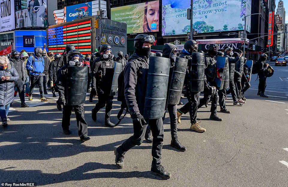 Show of force: The black-clad protesters marched through the streets of New York City in a protest which they hailed as an 'anti-fascist victory' because MAGA and Proud Boys rivals failed to show up