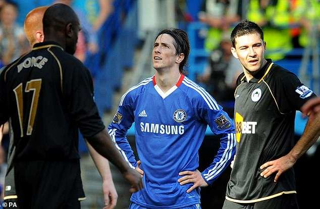 Fernando Torres, one of world football's deadliest strikers, seemingly became cursed when he swapped Liverpool for Chelsea in a British record £50million in January 2011
