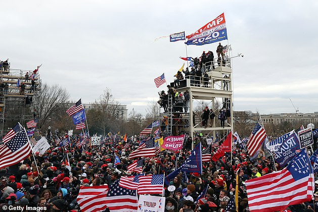 The mob climbed onto the stand built for TV cameras to record Biden's inauguration