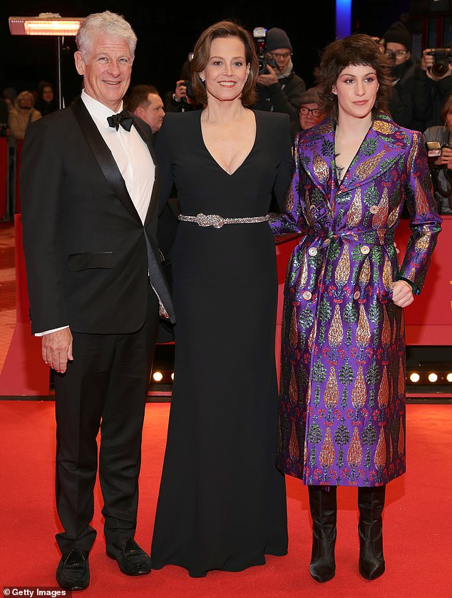Staying together: Sigourney is pictured with husband Jim Simpson and daughter Charlotte last year.  The couple have been married since 1984