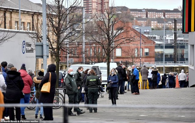 Newcastle residents queue around the block in the city centre as the mass vaccination hub on Tyneside openined