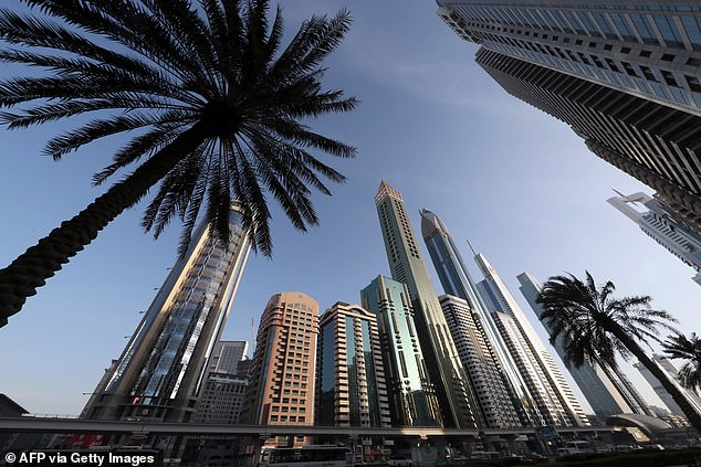 Travellers returning to the UK from the United Arab Emirates (UAE) will have to quarantine from tomorrow. Pictured: the 75-storey Gevora Hotel in the Gulf metropolis of Dubai