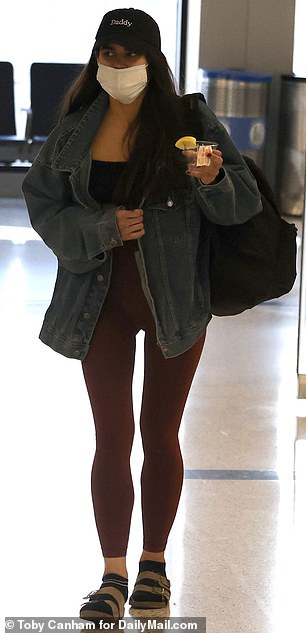 Oh dear: One person described Ponsetto's crop top-and-leggings look as 'trash'. She is seen wearing the outfit in LA after flying back to her home state from New York on January 10