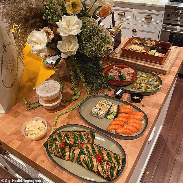 Yum: The second gallery photo showed a delicious spread of sushi and other appetizers, complete with a gorgeous bouquet of flowers and a white Prada shopping bag