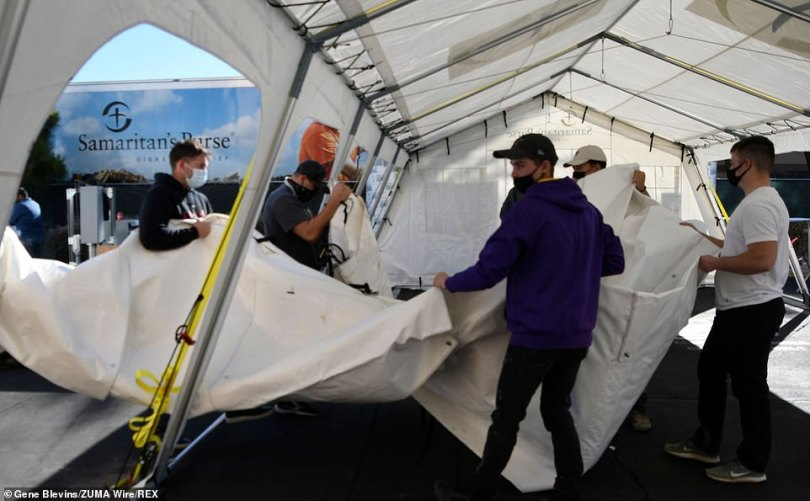 At Antelope Valley Hospital in Lancaster, residents were seen Monday setting up a field hospital in the parking lot