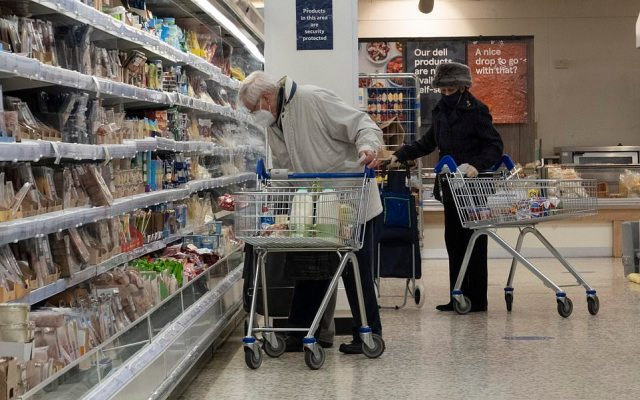 Britain's policing minister Kit Malthouse said police would intervene in serious breaches of Covid rules in shops. Pictured are Tesco customers following the rules at a store in London this morning