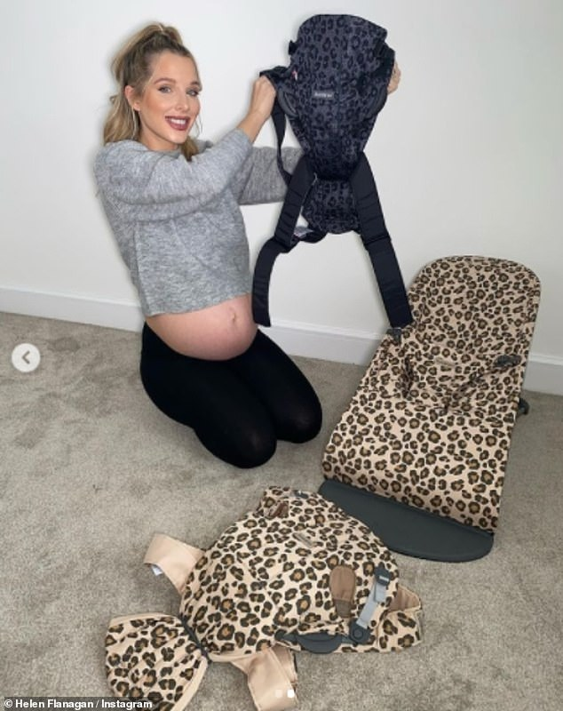 Radiant: The pregnant former Coronation Street star, 30, revealed her bare bump in a cropped grey jumper as she promoted an array of leopard print baby products by BabyBjörn