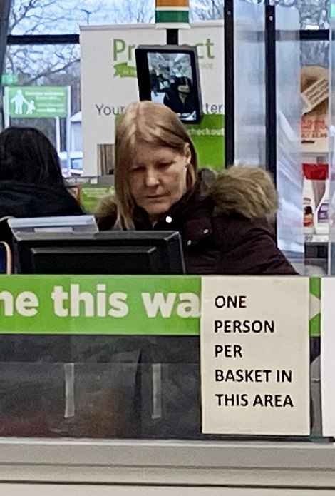Customers not wearing masks at an Asda in Swindon. It is not clear if the customer on the pictured had a medical exemption