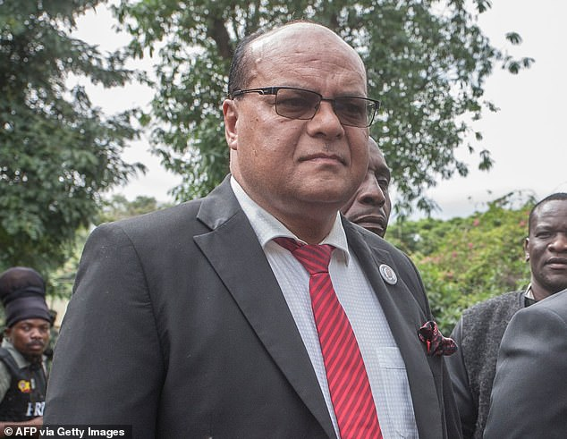 Malawi'sTransport Minister Sidik Mia (pictured) has died from Covid-19 as infections rise in the southeastern African nation