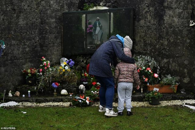 A mother and daughter pay their respects yesterday at a memorial for the mothers and daughters of Tuam, Co. Galway, where a mass grave of 796 babies was uncovered six years ago
