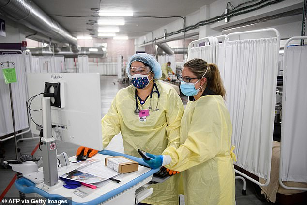 Some epidemiologists say an increase in cases could be due to more indoor gatherings or colder temperatures. Pictured:Respiratory therapists configure a remote monitoring device for a hospital at home program at Renown Regional Medical Center in Reno, Nevada, December 2020