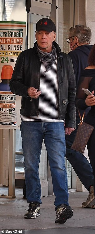 Outing:Bruce Willis appeared to ignore government guidelines as he stepped out without a face mask during an outing in Los Angeles on Monday