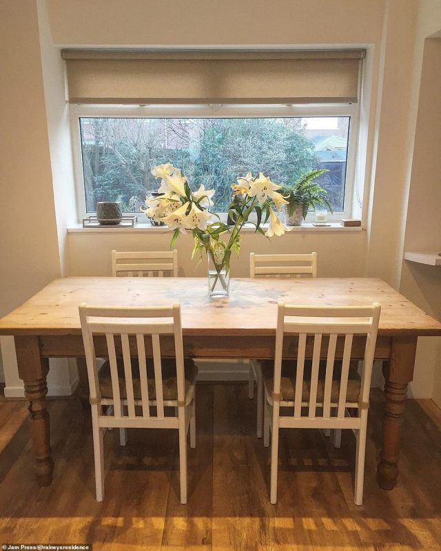The dining room now features a stylish table and white wooden chairs - ready for the first-time homeowner to have guests round when possible