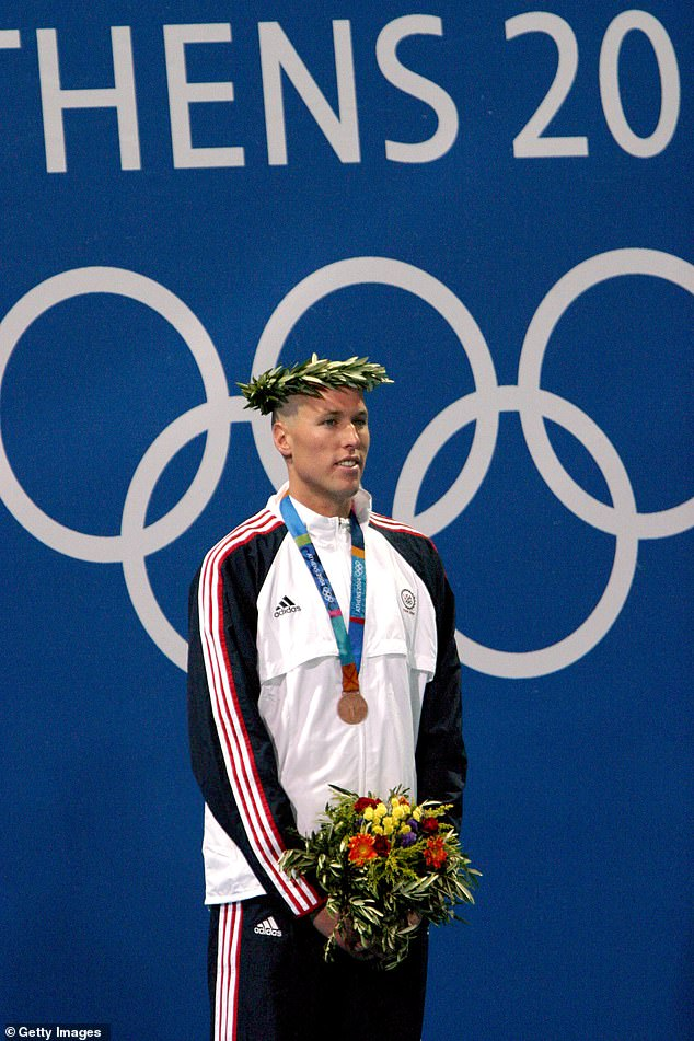 Keller is pictured collecting his bronze medal for the 400m freestyle at the 2004 Olympics
