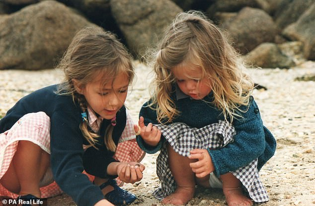 The pair, pictured as children playing on a beach, designed the app as an alternative to swiping