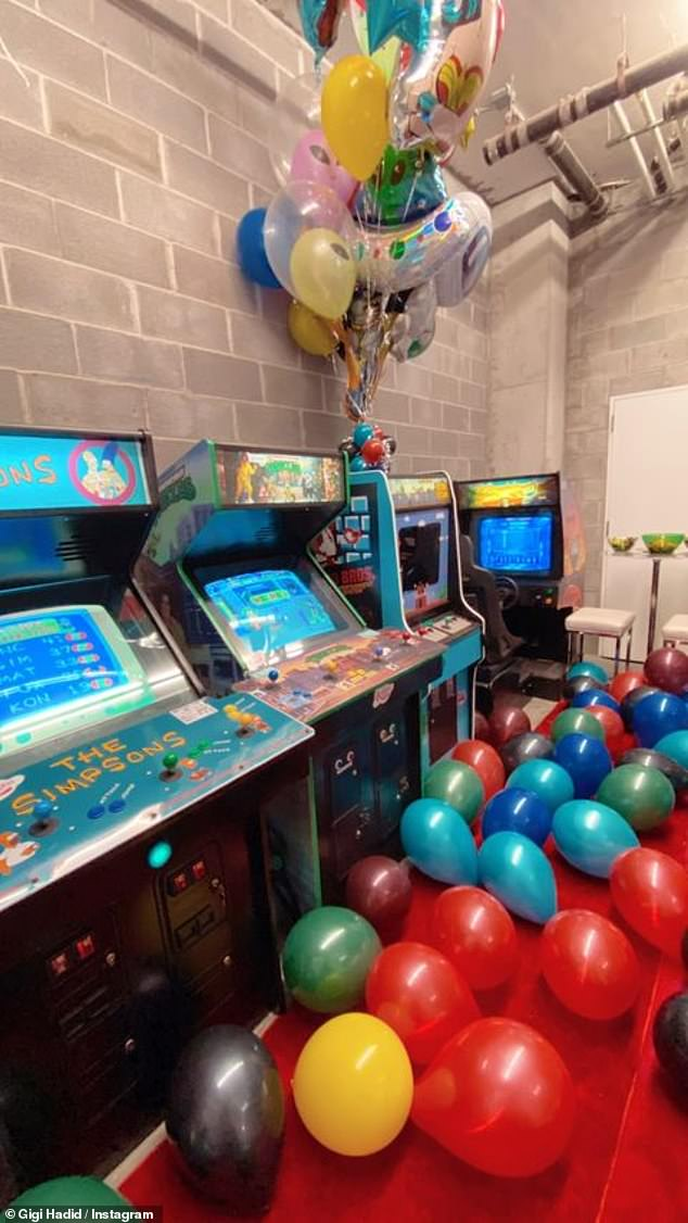 Ready for fun!  The room was filled with arcade games and colorful balloons