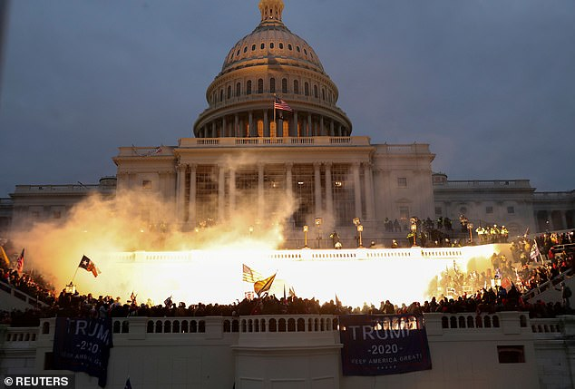 A view of flash bangs being used to disperse the swathes of Trump supporters to rioted at the Capitol on January 6 to protest the certification of the presidential election