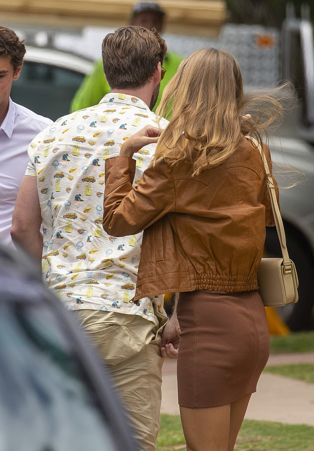 Fab: Gabriella looked sensational in a brown miniskirt and a matching jacket with a cream coloured Louis Vuitton handbag