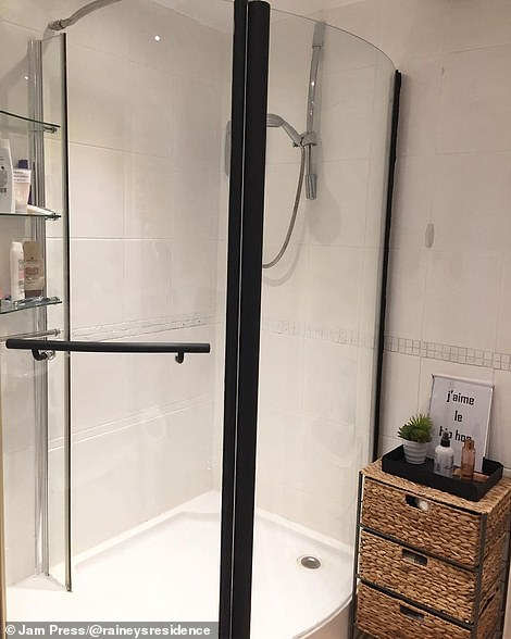 The bathroom after. It now has a modern shower and practical storage units for the savvy homeowner to use