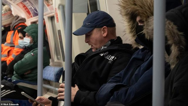 A London commuter is pictured not wearing a face mask on the Jubilee line today. It is not known if he has an exemption