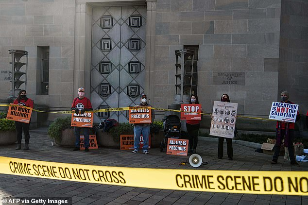 Pictured:Demonstrators protest federal executions of death row inmates, in front of the US Justice Department in Washington, DC, on December 10, 2020
