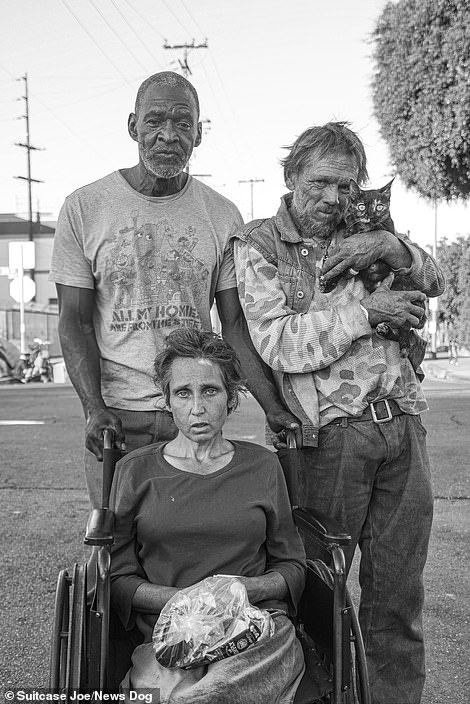 Bruce, left, pushes his friend as they go for a stroll whilst Pepper, right, holds his cat Justice as they come together to pose for a family style photo