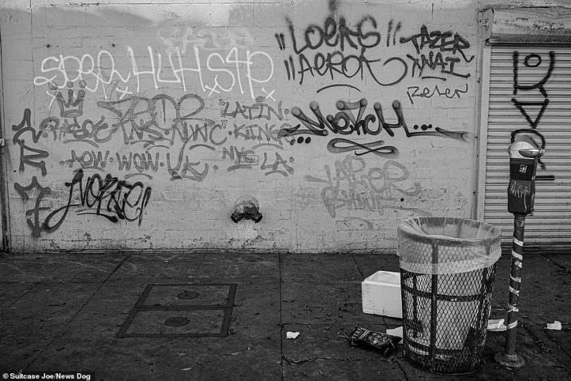 Graffiti and litter is strewn around a street in Skid Row.Covering fifty city blocks (2.71 sq mi) immediately east of downtown Los Angeles, Skid Row is bordered by Third Street to the north, Seventh Street to the south, Alameda Street to the east, and Main Street to the west