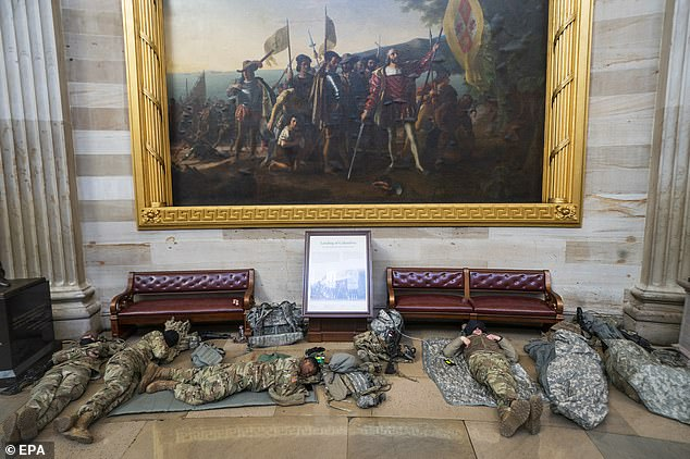 Troops were called in following the Capitol breach last week and by the end of the week there will be 10,000 National Guard members in Washington D.C. Some are shown spreading out inside the Rotunda of the U.S. Capitol on Wednesday morning