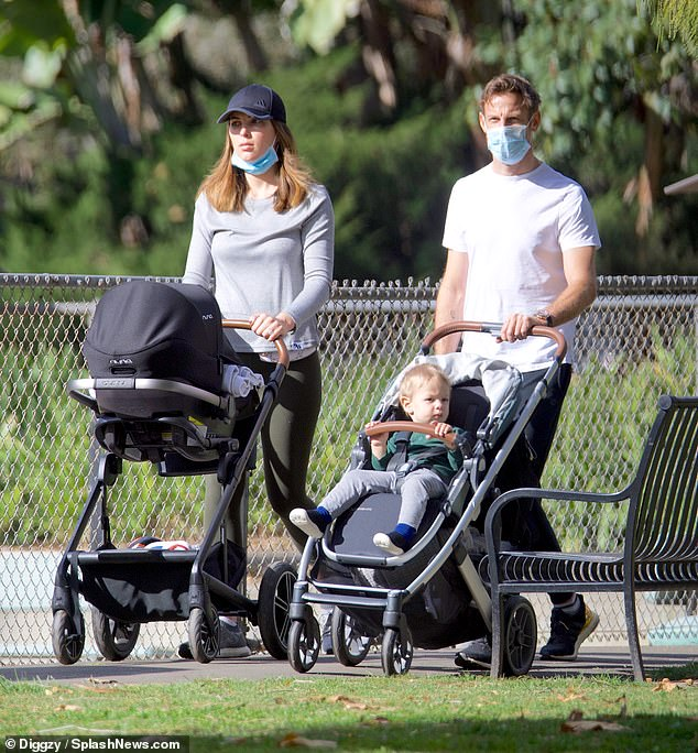 Relaxed look: The model looked amazing after giving birth just three weeks ago.  She wore a loose gray long sleeve top and khaki leggings