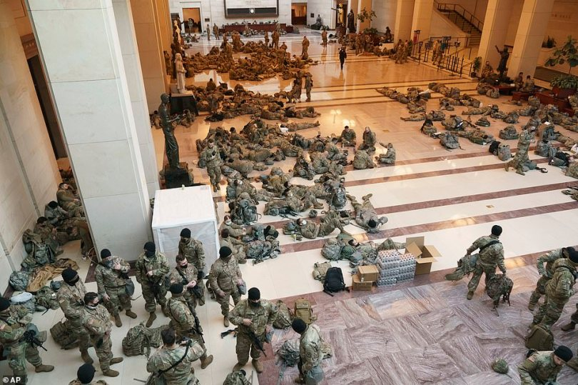 Hundreds of National Guard troops wer sleeping on the stone floor of the US Capitol on Wednesday morning as security in Washington intensified a week out from Joe Biden's inauguration
