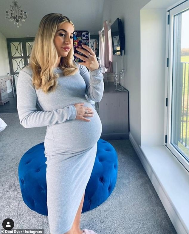 Bump Up Kindly: Pregnant Dani Dyer gently rocked her round belly in a gray midi dress as she showcased her new line of maternity clothes for InTheStyle on Wednesday