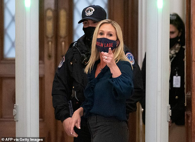 Rep. Marjorie Taylor Greene,who has objected to wearing a face mask in the past, was wearing one Tuesday night. It read Molon labe, which means 'come and take them' and is an ancient Greek expression that is a classical expression of defiance