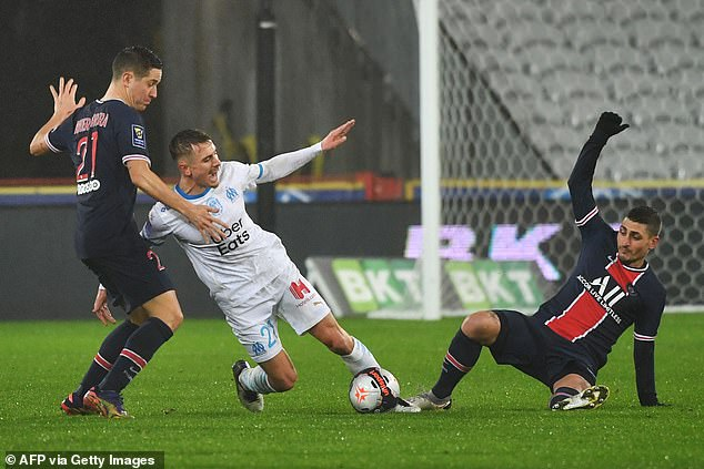 Marseille defender Valentin Rongier challenges for the ball with PSG's Marco Verratti