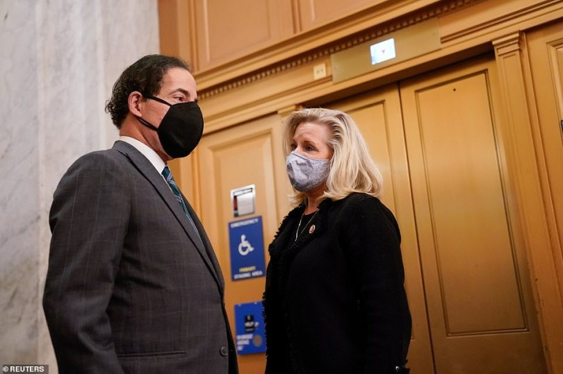 Republican House number three Liz Cheney (right) led 10 of the House GOP into voting for impeachment - but is now facing a backlash from Trump ultra-loyalists. She was see n speaking to Jamie Raskin, one of the key Democrats pushing for Trump's impeachment and removal