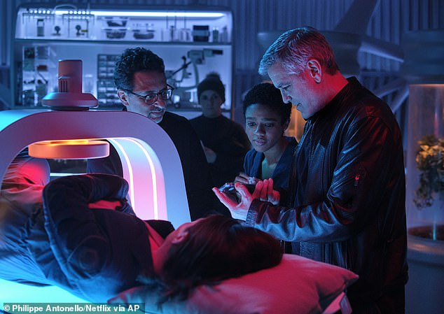 Clooney directing the ultrasound scene: Therefore, the British 37-year-old's (L) astronaut character Dr. Iris 'Sully' Sullivan was re-written undergoing an ultrasound and experiencing morning sickness before a spacewalk