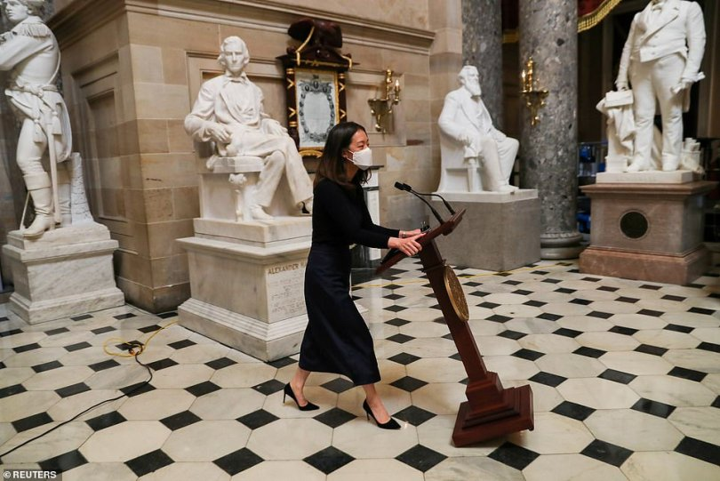 House Speaker Nancy Pelosi's lecturn has returned to its usual spot in the U.S. Capitol, one week after it was carried off as President Donald Trump's supporters stormed the building