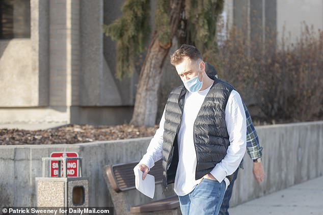 Colt kept his head down as he left jail.He's due back in court on January 19