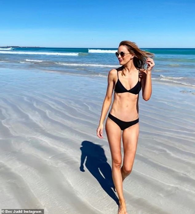 Beach Babe: Footy WAG Rebecca Judd spent Thursday at the beach as she revealed the luxury essentials she takes with her