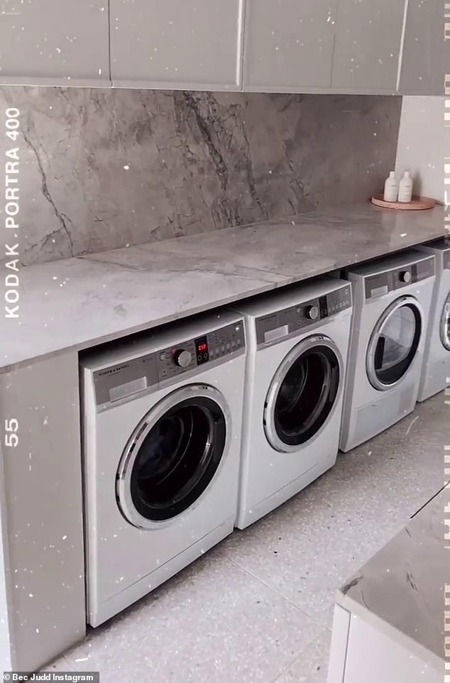 Every mother's dream!  As she gave her followers a tour of her Melbourne home in the upscale suburb of Brighton, she showed off the laundry room, which included four identical Fisher and Paykel washer / dryers, all lined up in a row, costing around $ 1200.  by machine