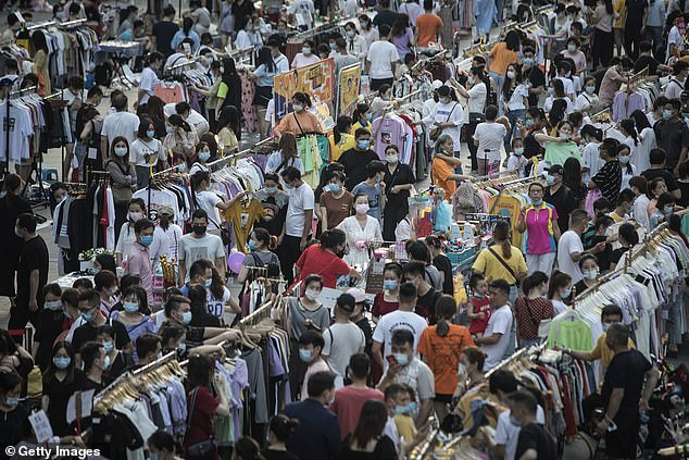 Night markets in Wuhan, China (pictured above) are always teaming with people