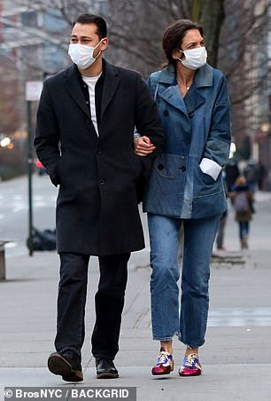 Bundled: Though stylish, the denim blazer did not seem to be providing optimal warmth as they strolled through a chilly NYC