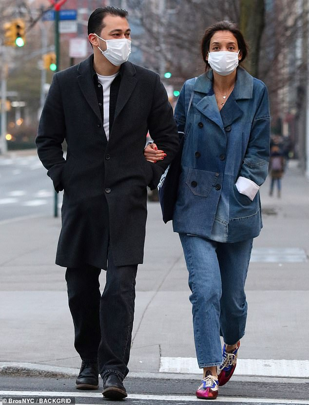 Creature of habit: Katie Holmes, 42, rocks a nearly identical denim outfit two days in a row while on a romantic evening stroll with boyfriend Emilio Vitolo Jr., 33, in NYC