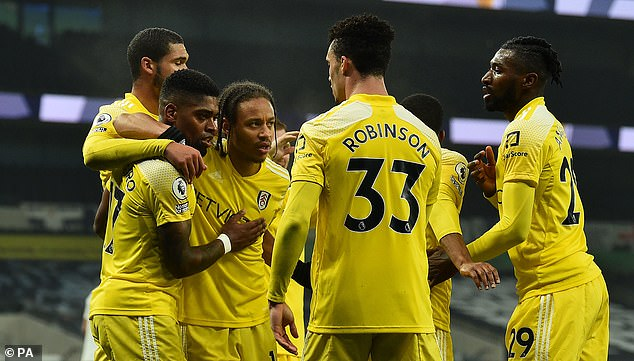 Fulham players came together after their late equalizer at Tottenham Hotspur