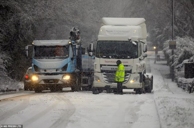 Traffic chaos in the village of Pool-in-Wharfedale near Leeds this morning as snow falls across West Yorkshire today